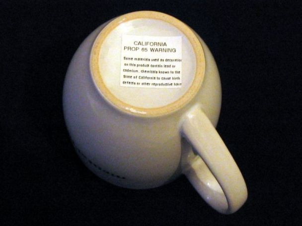 Coffee mug with Prop 65 warning label