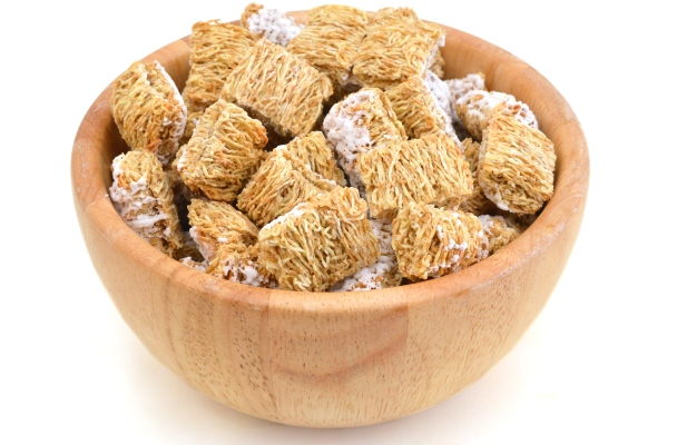 Breakfast setting with frosted wheat cereal in wood bowl