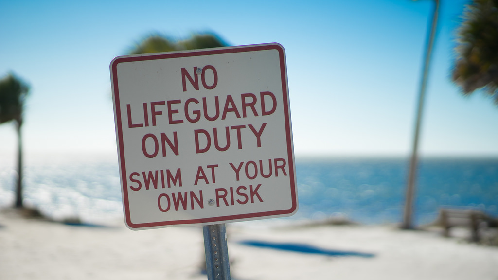 No Lifeguard on Duty - Swim at Your Own Risk sign
