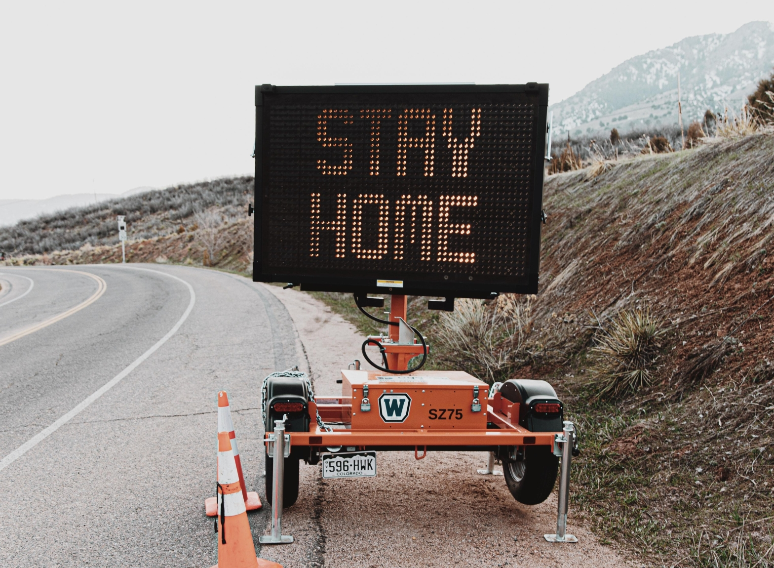 Stay Home on street construction sign